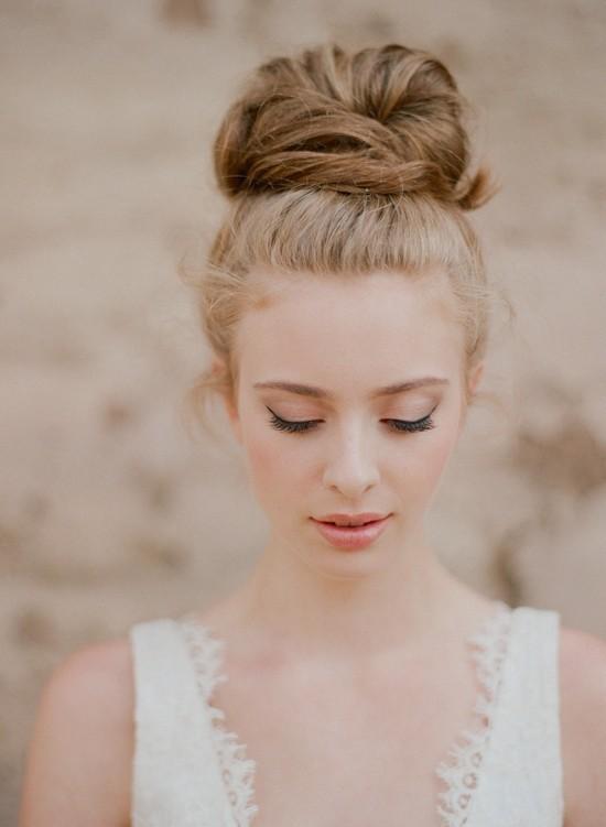 1404719195_top-knot-romantic-wedding-hairstyle-3.medium_large